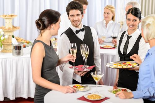 waiters serving guests catered event