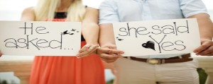Bride and groom with signs L.A. Banquets