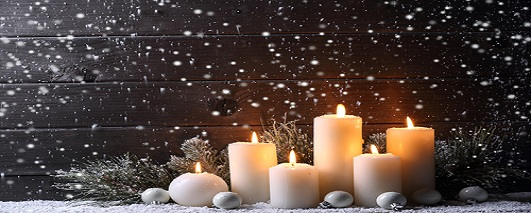 Snow falling on candles
